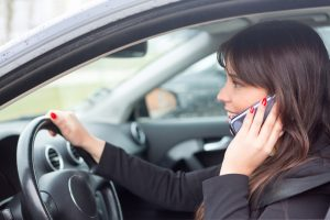 woman at the phone while driving