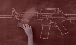 hand-erasing-gun-from-blackboard_Red filter