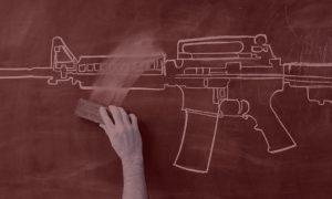 hand-erasing-gun-from-blackboard_Red filter