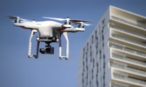 Security drone with camera and building